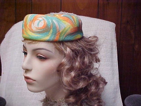 Brightly colored vintage Pill box hat