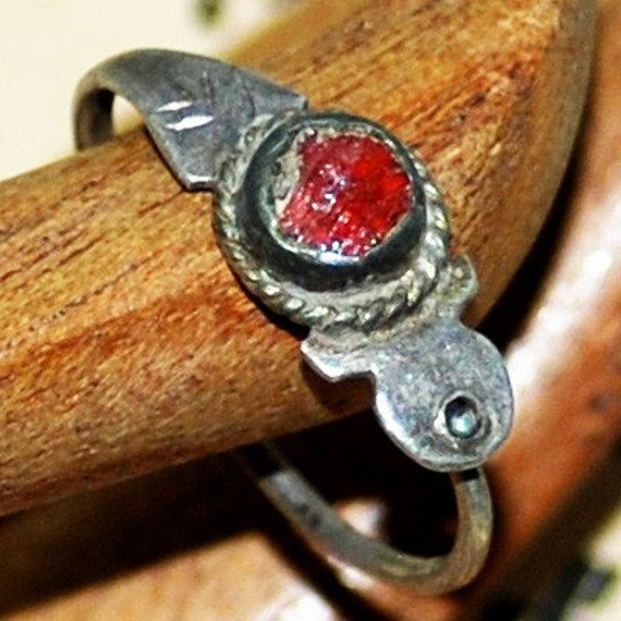 this little ring with red stone was the only thing that reminded her of that beautiful summer...  it was found in an arhceological dig...  size 5...  to use in your  mixed media JEWELRY or in any way you would want Feb 5