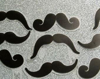 12 little plastic mustache toppers