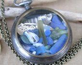 Pirates Booty Pendant Cobalt Blue Sea Glass, Bone, Shells, Jade in a Gunmetal Pocket Watch Case