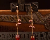 Pink and bronze dangle earrings