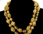 1940s Hong Kong Necklace with Plastic Butterscotch Flowers
