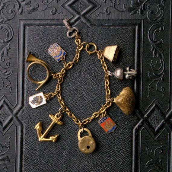 Sea Farer's Charm Bracelet. Ship. Enameled Shields. Coat of Arms. Anchor. Shells. African. Key. Mushrooms.