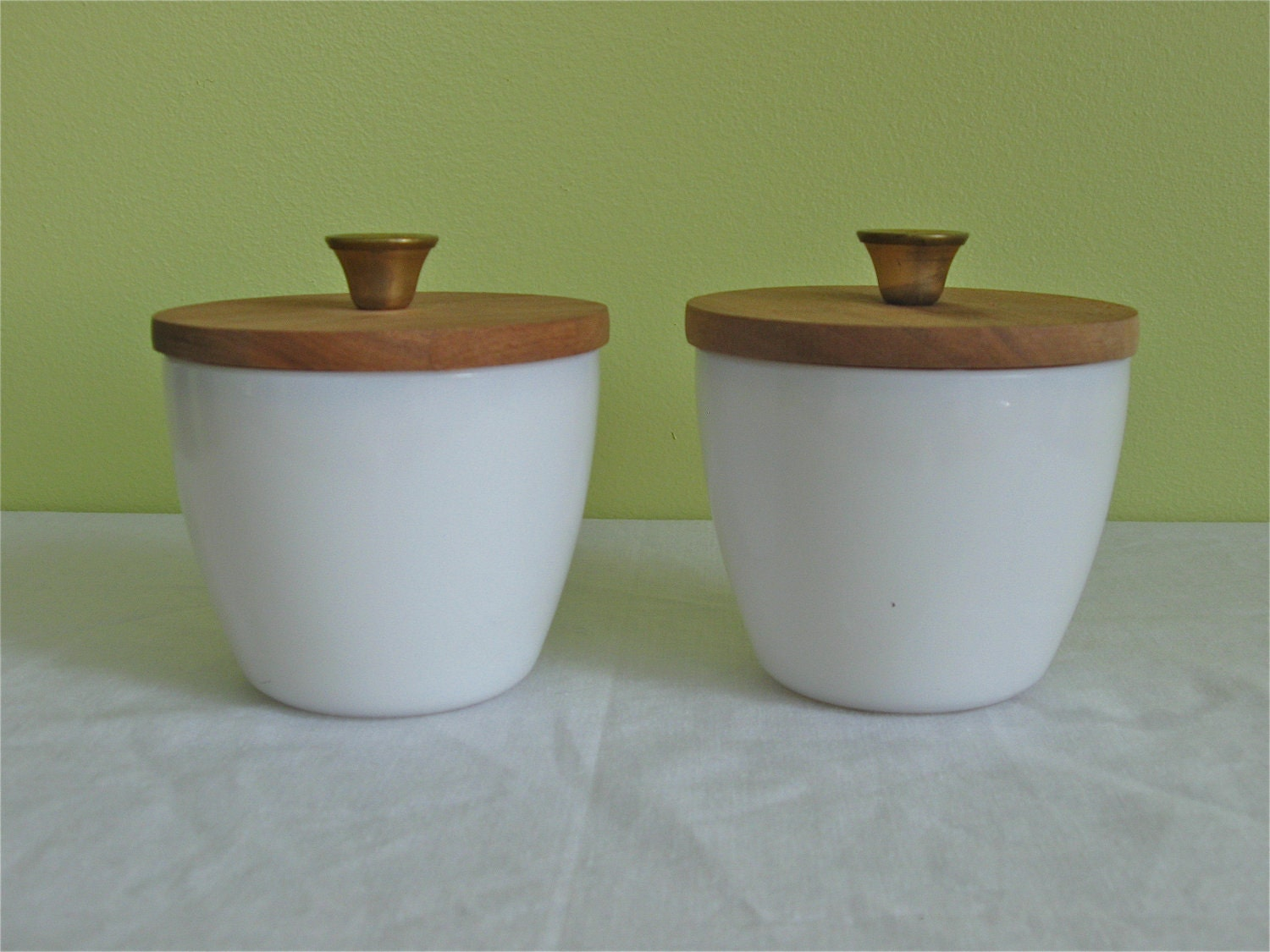 small milk glass jars with wooden lids set of two. Black Bedroom Furniture Sets. Home Design Ideas