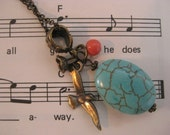 Turquoise and brass charm necklace