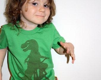 Toddler DINOSAUR on bicycle shirt (grass green)
