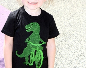 Dinosaur on a Bicycle- Kids T Shirt, Children Tee, Cotton Tee, Handmade graphic tee, sizes 2-12