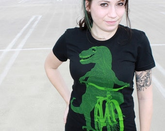 Tyrannosaurus Rex Dinosaur on a Bicycle Shirt - Black T-Shirt - American Apparel Ladies - FREE SHIPPING - Available in S, M, L, and Xl