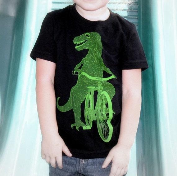 Kids DINOSAUR t rex on bicycle T-Shirt (Sizes 2-12)