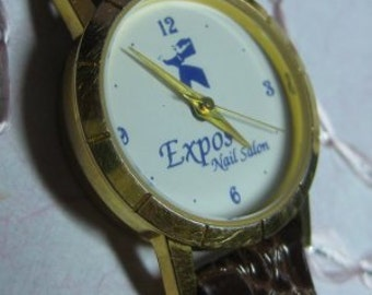 Watch collectible  18k gold plated New Battery  Thin  Vintage Nail Salon Expos Logo  On Clearance Now