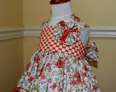 Luscious Reverse Knot dress in lovely summer print