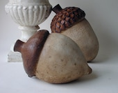 two cement acorns