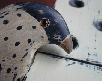 folk art bird and domino sculpture