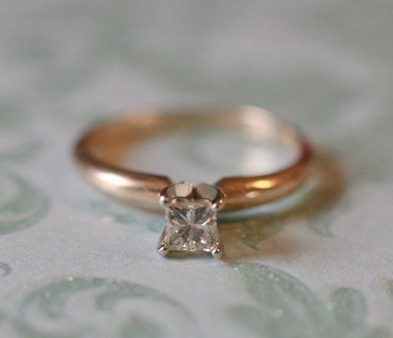 Eye catching 14k yellow gold engagement ring with .27 carat princess diamond.
