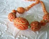 Vintage Celluloid Necklace Orange and Creme Carved Flowers