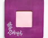 Purple photo frame with an ornament