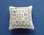 A cute little abc \/ 123 sampler pincushion .A lovely little gift .....
