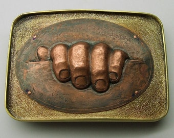 Belt buckle. Copper, hand chased