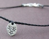 Wish Upon a Star. Tiny Sterling Silver Hand Stamped Star Bracelet on Cord.