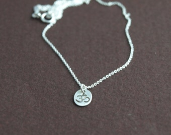 Breathe. Tiny sterling silver hand stamped OM necklace.