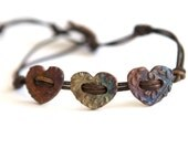 Rainbow Patina Copper Heart Button Bracelet on Brown Leather