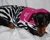 Zebra coat with pink accents