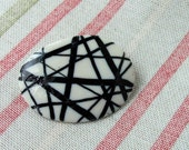 Porcelain crossing lines oval brooch
