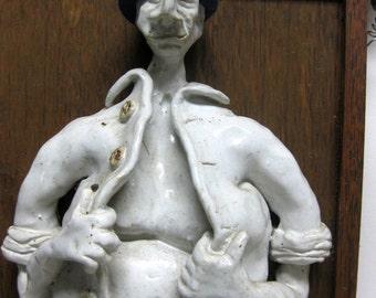 Mr. Flasher Ceramic wall Sculpture