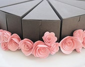 Chocolate paper cake slice with pink flowers