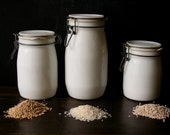 3 Milk Glass Storage Canisters with Bale Wire Glass Lids Vintage from Nowvintage on Etsy