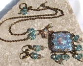 Lost Atlantis - Iridescent Blue Glass Filigree Wrapped Medallion Art Glass Necklace Set - Coco Scapin Designs Chicago