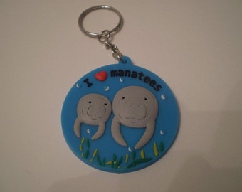 I love manatee key chain w/Mom and calf and sea grass