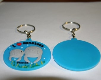 I love manatee key chain w/Mom and calf and sea grass w/Florida at bottom