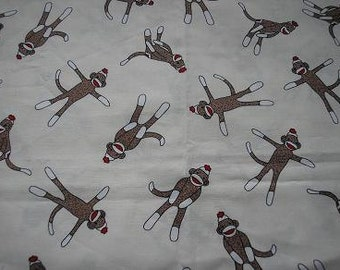 SALE   4 yds of  Tossed sock monkey fabric on cream by Moda