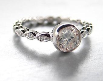 engagement ring, white sapphire center stone. 14k white gold.