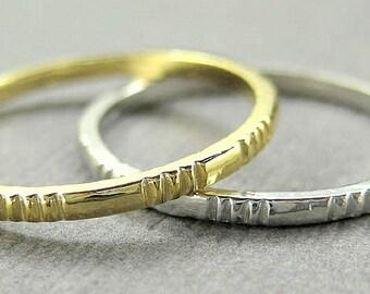 Wedding band, 14k gold ribbed texture.