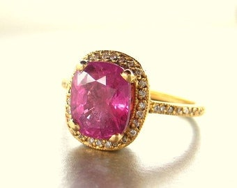 18K gold ring with  Pink Sapphire ring and diamonds.  Engagement ring