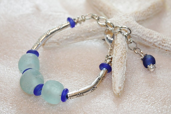 Eco friendly Sea foam and cobalt blue Sea glass beads with antique tibetan silver cannula curved bracelet.
