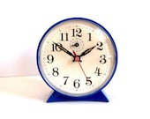 Vintage bright blue plastic alarm clock made in Germany