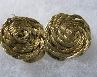 Round clip back vintage gold tone earrings with swirl design. vintage clip ons