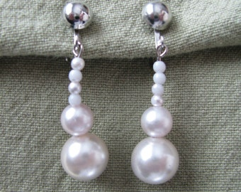 White stacked bead faux pearl drop clip on clip back earring. Vintage earrings
