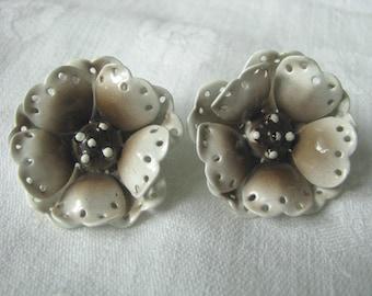 Enamel flower clip earrings in shades of tan and brown