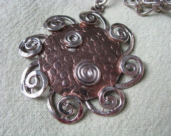 Round copper tone vintage necklace with silver tone spiral accents.  by ART