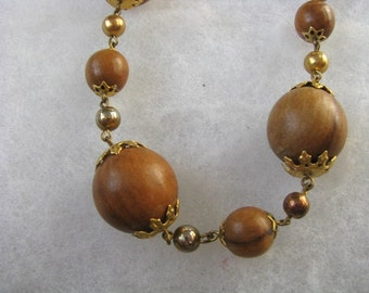 Nut brown vintage bead necklace with gold tone accents