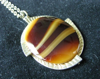 Gold tone vintage necklace with oval tigers eye inset.  CARMEL TONES by Sarah Coventry