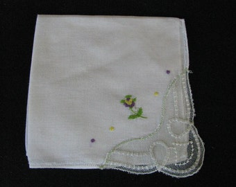 Simply darling white handkerchief with purple & yellow embroidered flower and lace corner