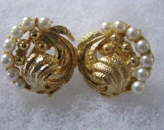 Fancy gold tone swirl leaf clip back clip on earrings with faux pearls