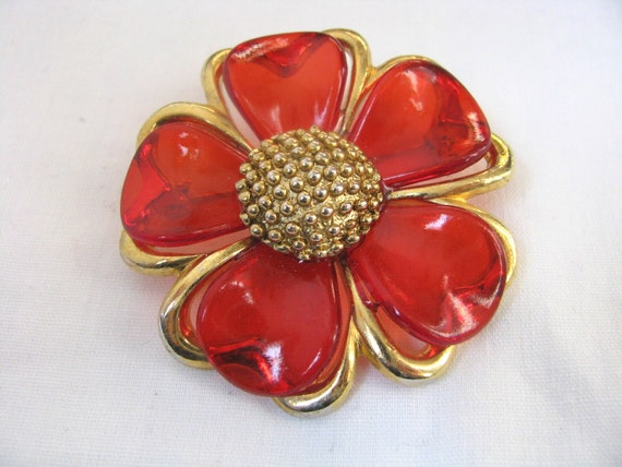 Brooch. Gold tone flower pin translucent red plastic petals Hold PS