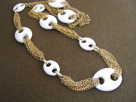 Fun long gold tone vintage necklace with white oval loops