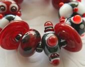 Glass lampwork beads black red